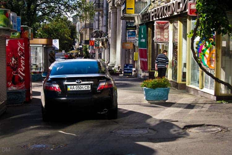 Cars parked and driving on the pavement or sidewalk are a common danger in Kiev
