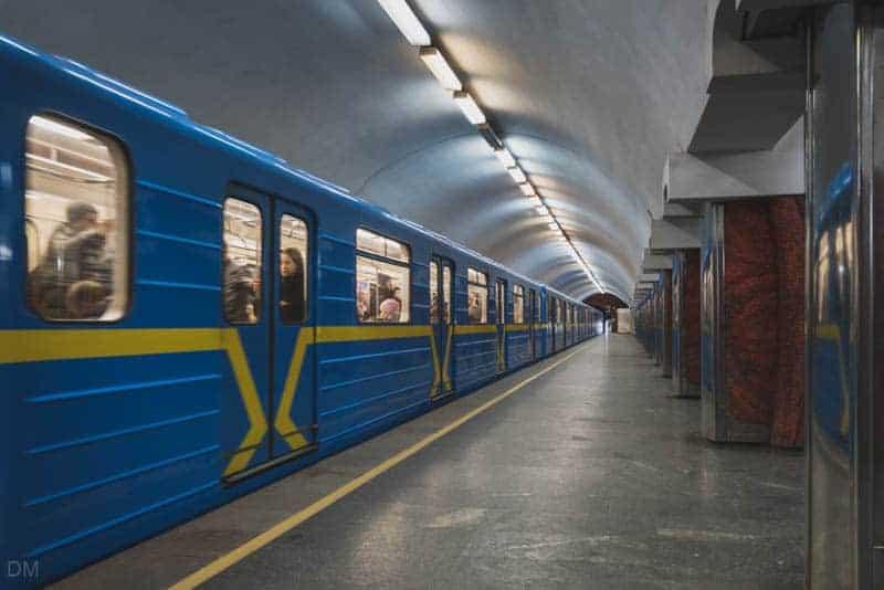 Metro train at platform of Palats Ukrayina Metro Station in Kiev, Ukraine