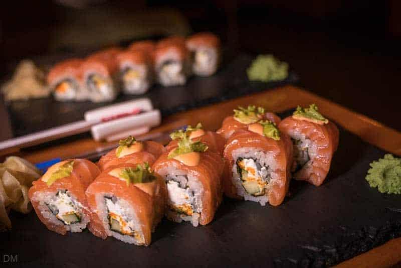Salmon roll with fresh basil, sushi roll